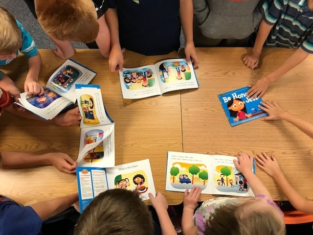 Students loving the pictures of the new books.