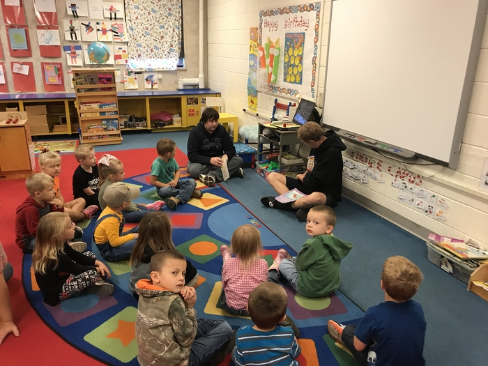 Reading to preschool.