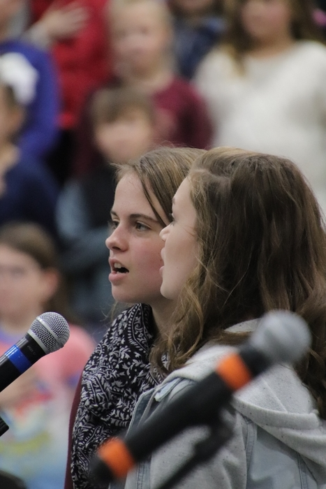 Samantha Schrum and Lucy Rains, singing the National Anthem