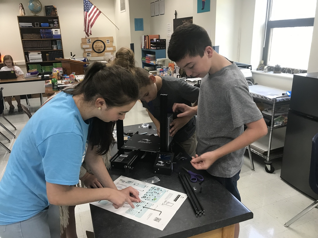 The 8th graders are assembling the 3D printer for the new STEM lab!